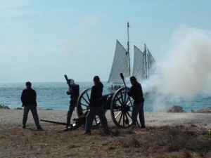 Field artillery being fired on sailing ship during Civil War Heritage Days.