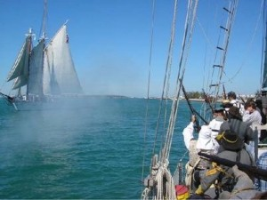 Confederate soldiers on sailing ship fire at Union ship during Civil War Heritage Days.